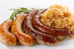 慕尼黑啤酒节食物香肠菜单、板材和德国泡菜 图库摄影