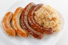 慕尼黑啤酒节香肠菜单、板材和德国泡菜 免版税图库摄影