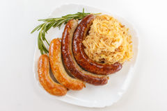 慕尼黑啤酒节香肠菜单、板材和德国泡菜 库存图片