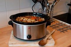 慢的烹饪器材 免版税图库摄影
