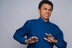 懊恼非裔美国人的少年是恶心的 免版税库存照片