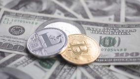 戈尔德和银bitcoin Litecoin在转动美元 换隐藏货币的概念 财务的概念 影视素材