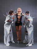 戈戈舞的舞蹈家三重奏色情服装的 图库摄影
