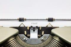 戏剧词用大写字母在白色板料 库存图片