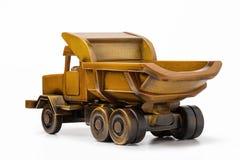 戏弄卡车转储卡车由自然木头,背面图制成 免版税库存照片