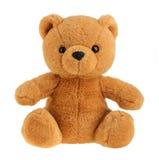 戏弄在白色隔绝的玩具熊,保险开关 库存照片