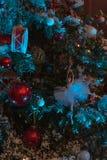 戏弄垂悬在圣诞树的一点天使 免版税库存图片
