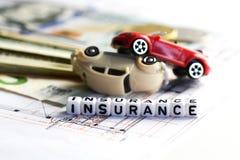 戏弄车祸损伤和保险词从铺磁砖的信件块 库存图片