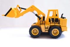 戏弄建筑车,黄色,被上升的桶 库存照片