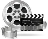 戏院在白色的拍手和影片轴 免版税库存图片