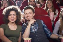 戏院大厅微笑的两个朋友 图库摄影