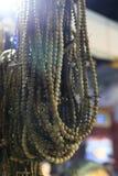 成串珠状木的祷告 免版税图库摄影