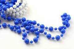 成串珠状查出的蓝色 库存照片