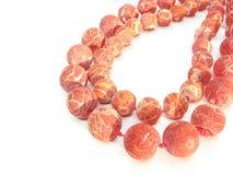 成串珠状珊瑚红色 免版税库存照片