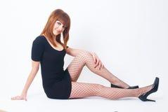 成串珠状美丽的女孩头发的红色 免版税库存照片