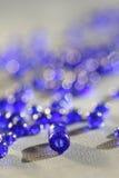 成串珠状蓝色 免版税库存图片