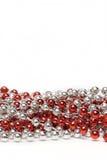 成串珠状装饰红色银色 免版税库存图片