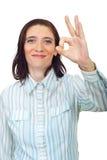 成人中间好的显示的符号微笑的妇女 库存图片
