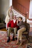 成人夫妇女儿家前辈沙发 免版税库存照片