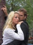 成人夫妇拥抱年轻人 库存图片