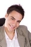 成人微笑的年轻人 免版税库存图片