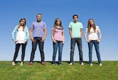 成人新组的少年 免版税库存图片