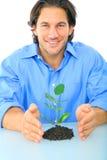 成人绿色寿命保护的年轻人 免版税库存图片