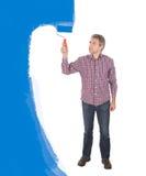 成人蓝色绘画前辈墙壁 免版税图库摄影