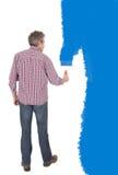 成人蓝色绘画前辈墙壁 免版税库存图片
