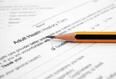 成人表单健康历史记录 免版税图库摄影