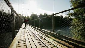 年轻成人走在桥梁 影视素材