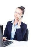 成功女商人谈话在电话 免版税图库摄影