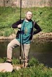 成功渔,有钓鱼竿的人 滑稽,乐趣 库存图片