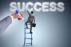成功的商人的手图画梯子 库存图片