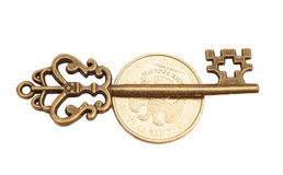 成功的钥匙在硬币 免版税库存图片