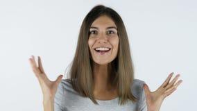成功的兴奋由愉快的女孩,白色背景的在演播室 影视素材
