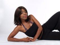 成套装备裤子斜倚的妇女 图库摄影