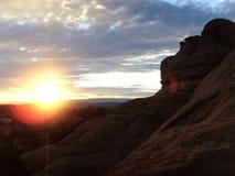 成拱形在日出的峡谷 免版税库存照片