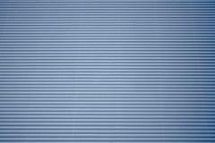 成波状的蓝色纸板 图库摄影