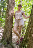 成熟妇女在森林 库存图片