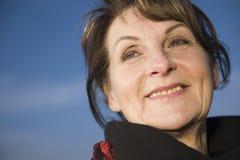 成熟妇女的愉快的面孔 免版税库存图片