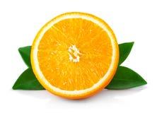 成熟橙色果子的半部分与在白色隔绝的叶子的 免版税库存图片