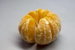 成熟橙色果皮为在白色背景吃 免版税库存图片