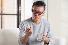 成熟的亚裔前辈 免版税库存照片