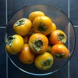 成熟的柿子 概念-健康吃,素食主义 免版税库存图片