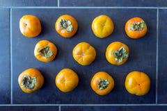成熟的柿子 概念-健康吃,素食主义 库存图片