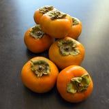 成熟的柿子 概念-健康吃,素食主义 selec 免版税库存照片