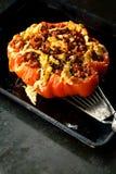 成熟红色与辣充塞的烤蕃茄 图库摄影