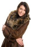 成熟羊皮佩带的妇女 免版税库存图片