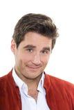 成熟英俊的人蓝眼睛微笑的画象 免版税库存图片